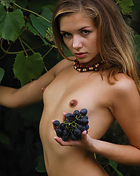 Petite beautiful sexy Russian girl posing naked with grapes